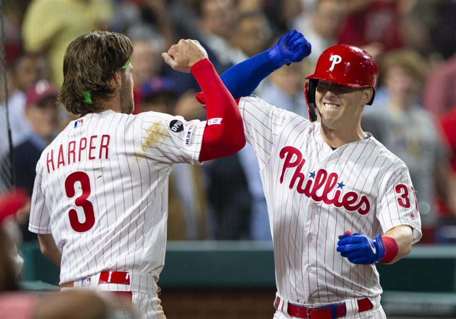 The Phillies' Bryce Harper celebrates with Corey Dickerson after Dickerson hit a 2-run home run against the Pittsburgh Pirates on Monday night.