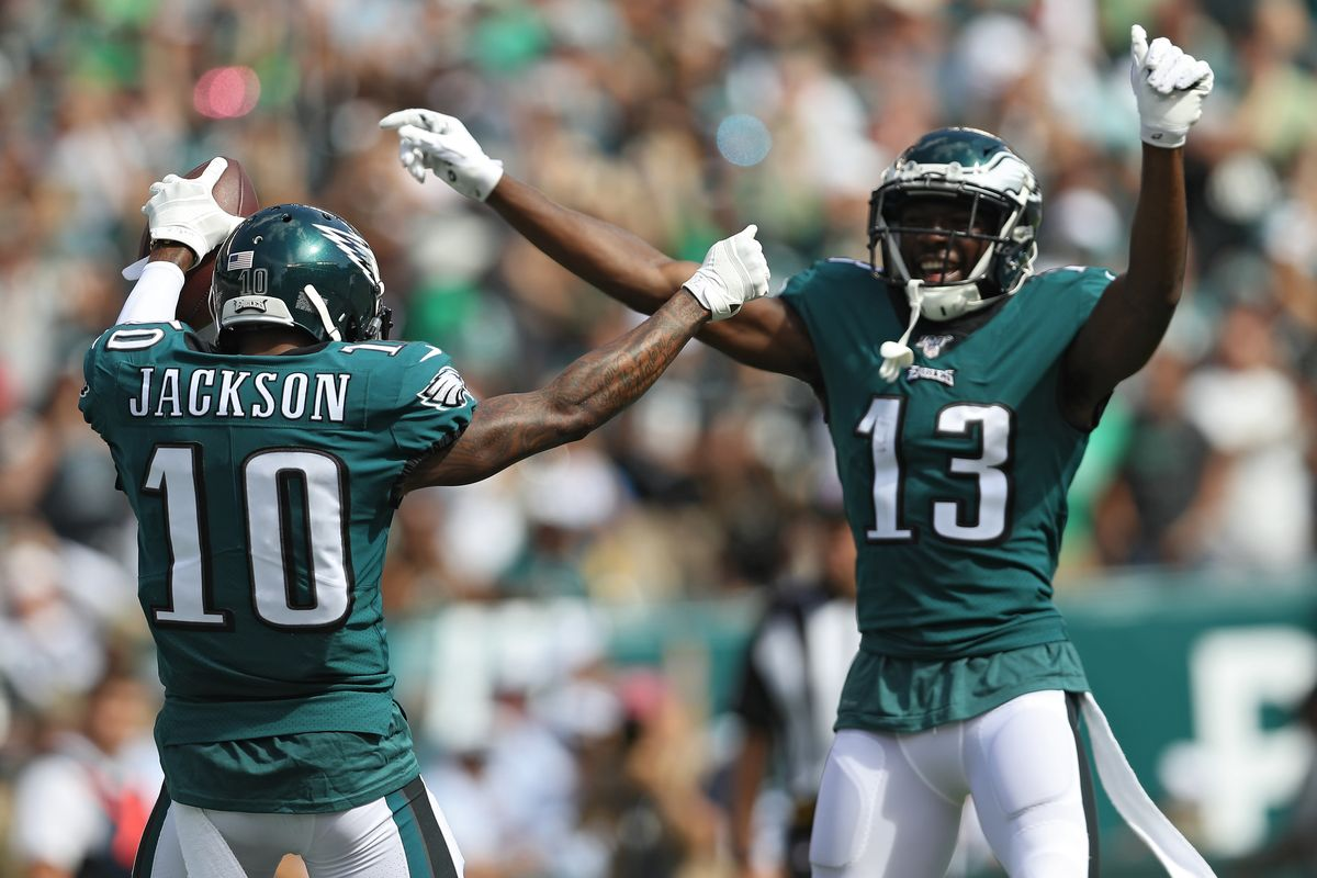 Eagles' recievers DeSean Jackson and Nelson Agholor celebrate the Eagles' 32-27 win over the Washington Redskins on Sunday.