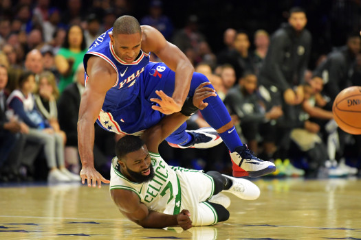 PHILADELPHIA, PA - OCTOBER 23: Al Horford #42 of the Philadelphia 76ers falls over Jaylen Brown #7 of the Boston Celtics at Wells Fargo Center on October 23, 2019 in Philadelphia, Pennsylvania. NOTE TO USER: User expressly acknowledges and agrees that, by downloading and or using this photograph, User is consenting to the terms and conditions of the Getty Images License Agreement.  (Photo by Drew Hallowell/Getty Images)