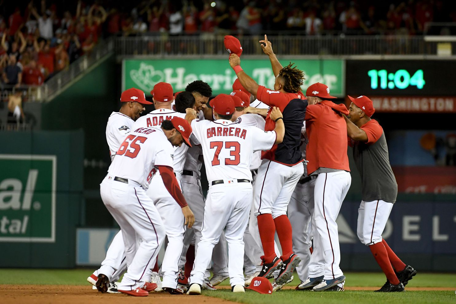 The Washington Nationals celebrated their 4-3 win over the Milwaukee Brewers in the National League Wild Card game on Tuesday night.
