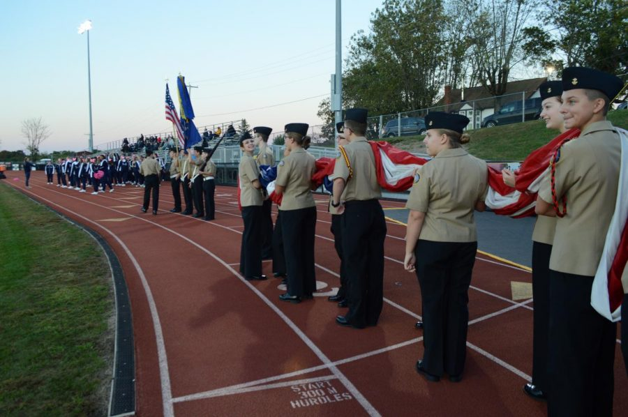 NJROTC+prepares+to+begin+the+game+with+the+moment+of+silence.