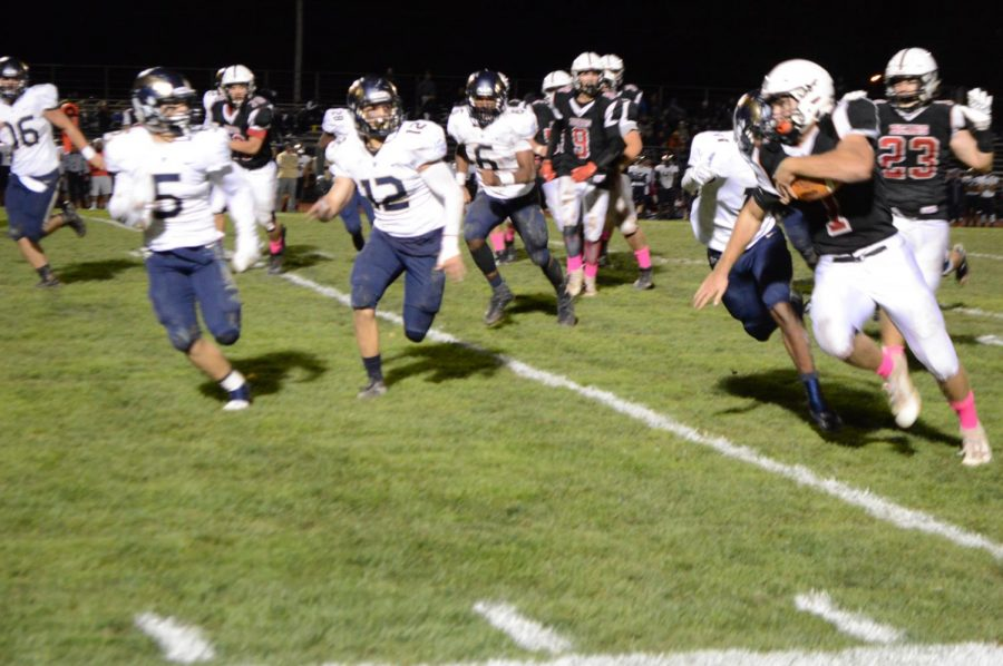Jamie Moccia running with the ball; Springford and Boyertown have a long-held rivalry.