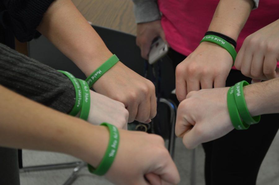 Students+wear+bracelets+with+the+messages+%22Mental+Health+Matters%22+and+%22You+Are+Not+Alone%22+for+Mental+Health+Awareness+Day.+Bracelets+were+provided+by+SADD+to+every+student+in+the+building.