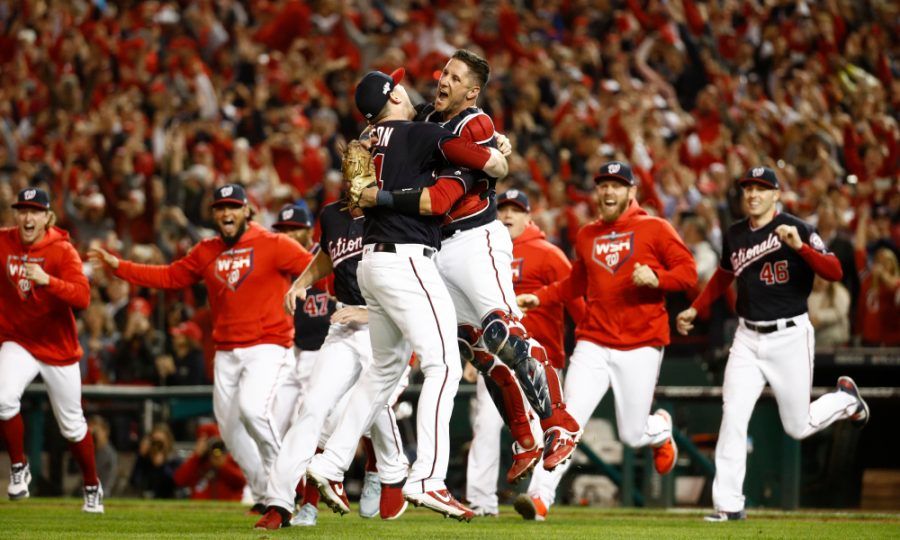 Washington Nationals' Yan Gomes and Daniel Hudson celebrate after Game 4 of the baseball National League Championship Series Tuesday, Oct. 15, 2019, in Washington. The Nationals won 7-4 to win the series 4-0. (AP Photo/Patrick Semansky) ORG XMIT: NLCS165