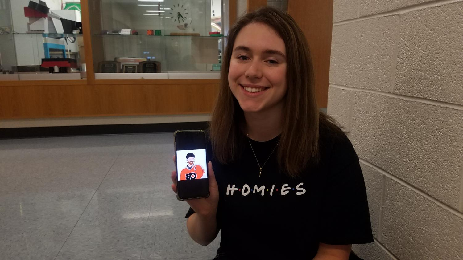 Senior Paige Wenhold, a big Philadelphia Flyers fan, is planning to not only open a Redbubble store, but to also combine sports and art—two topics that seem at odds. Her phone showcases one of her digital pieces that will be available as a sticker soon.