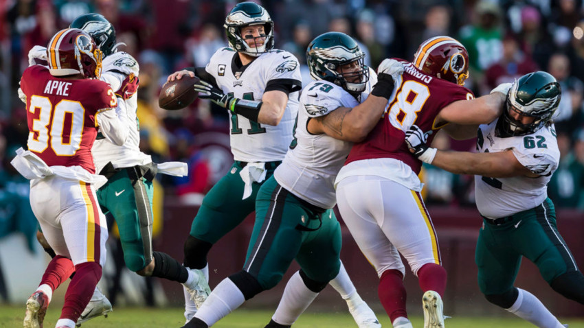 LANDOVER, MD - DECEMBER 15: Carson Wentz #11 of the Philadelphia Eagles attempts a pass against the Washington Redskins during the first half at FedExField on December 15, 2019 in Landover, Maryland. (Photo by Scott Taetsch/Getty Images)