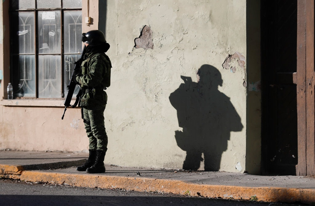 A member of the Mexican security forces standing guard outside City Hall in Villa Union last Tuesday.