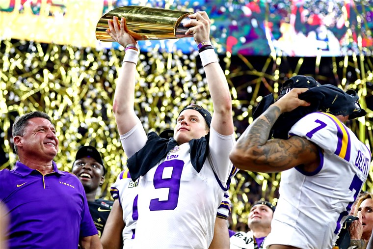 LSU+coach+Ed+Orgeron%2C+QB+Joe+Burrow%2C+and+safety+Grant+Delpit+are+presented+the+College+Football+Championship+trophy+as+LSU+defeated+Clemson+42-25.