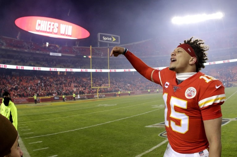 Chiefs' QB Patrick Mahomes celebrates the Chiefs' 51-31 comeback win to move on to the AFC Championship.