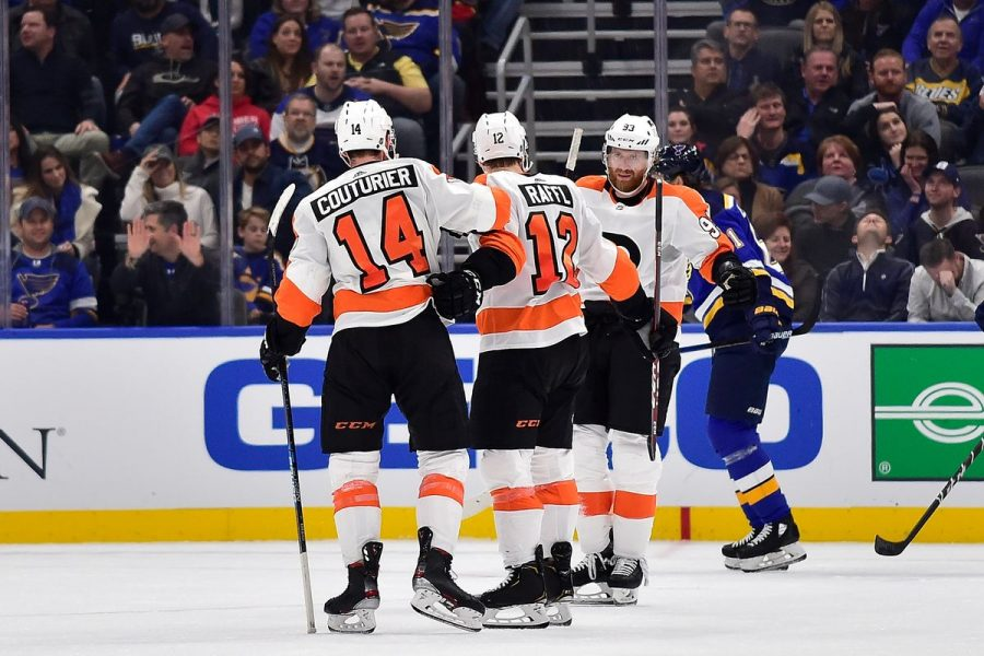 Flyers' Jakub Voracek is greeted by teammates Sean Couturier and Michael Raffl after scoring the game winning goal in overtime as the Flyers beat the Blues 4-3 on Wednesday.