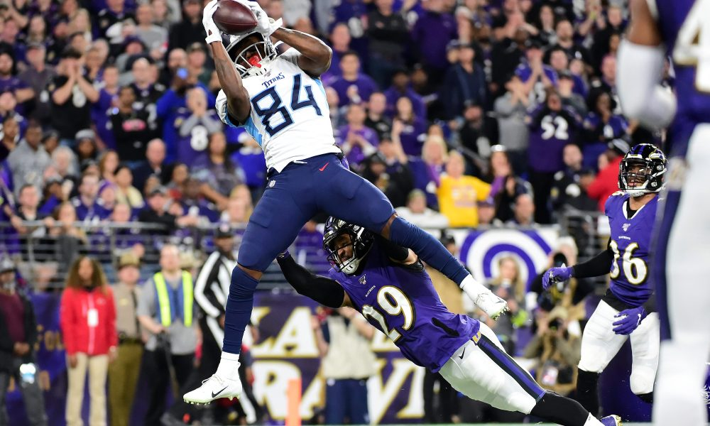 Tennessee Titans' wide-receiver Corey Davis catches a 3-yard touchdown pass from running back Derrick Henry as the Titans upset the Ravens 28-12 on Saturday night.