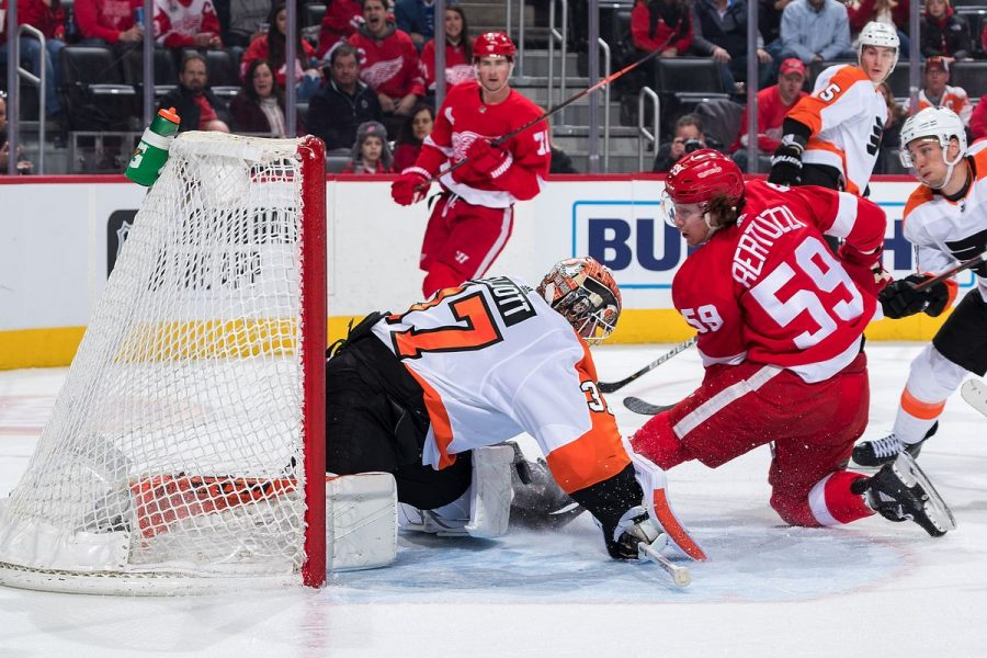 Flyers' goalie Brian Elliot stops Red Wings' Tyler Bertuzzi's shot attempt as he shut out the Red Wings 3-0 on Monday.