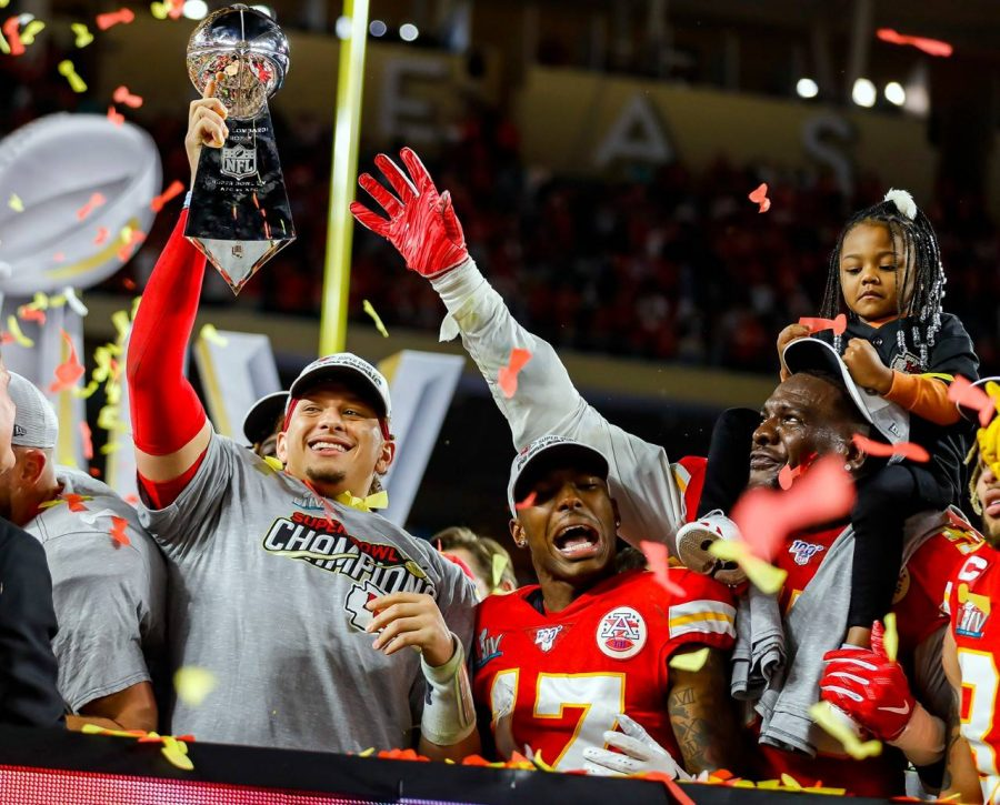Kansas City Chiefs' QB and Super Bowl MVP Patrick Mahomes Hoists the Lombardi Trophy as the Chiefs celebrated their first Super Bowl win on Sunday.