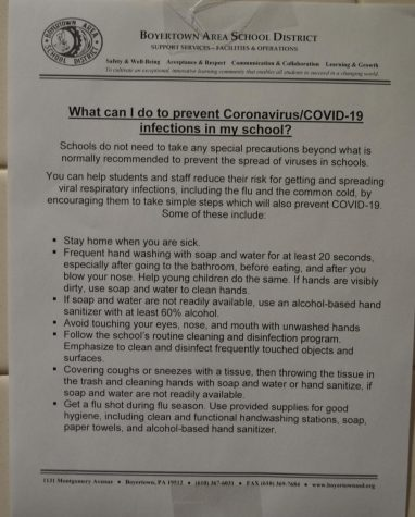 The school hung up fliers regarding health practices in case of COVID-19 exposure.