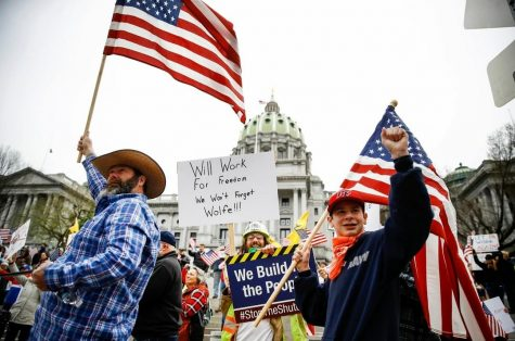 Hundreds of Pennsylvania residents gathered outside of the state capitol in Harrisburg Monday to protest shutdown measures.