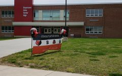 Seniors drove around the school this past week to drop off their laptops and books and pick up their graduation items.