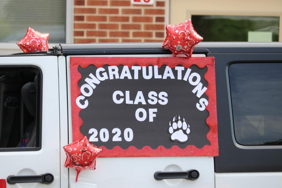Teachers, staff, and administrators from elementary, middle and high school drove to homes of graduates to hand-deliver diplomas