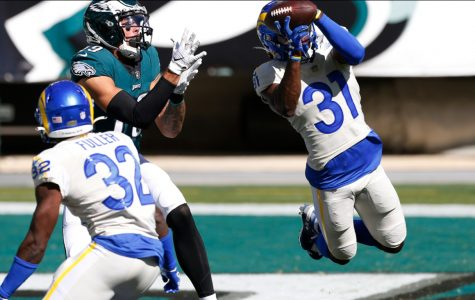 Rams cornerback, Troy Hill, intercepts a pass thrown by Eagles quarterback, Carson Wentz.