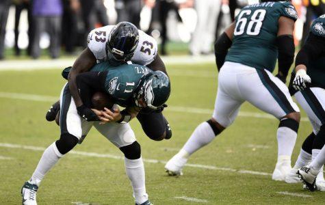 Philadelphia Eagles' Carson Wentz, is tackled by Baltimore Ravens' Jihad Ward.