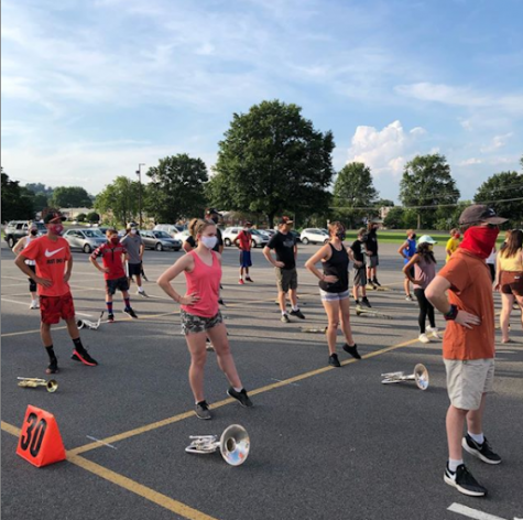BASH marching unit warming up during band camp