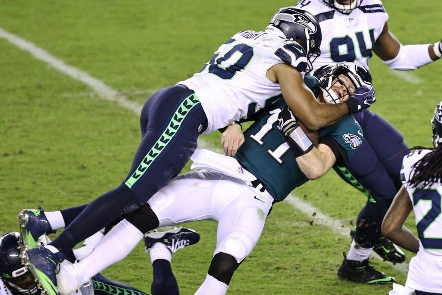 Eagles quarterback, Carson Wentz, gets sacked by Seahawks linebacker, K. J. Wright.