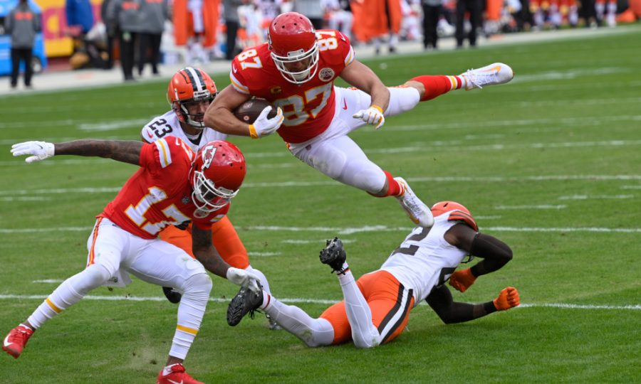 Kansas City Chiefs tight end Travis Kelce (87) leaps over Cleveland Browns safety Karl Joseph, right, during a 20-yard touchdown reception in the first half of an NFL divisional round game against the Cleveland Browns