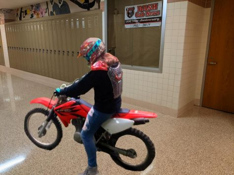 Grace Erb, 11th grader and experienced dirt-biking competitor revs up for the race! /Photo provided by Grace Erb