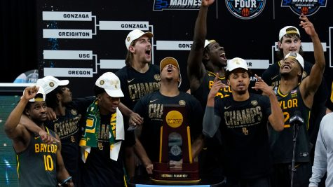 The Baylor Bears celebrate their first NCAA basketball championship in school history.  Photo by Darron Cummings/AP