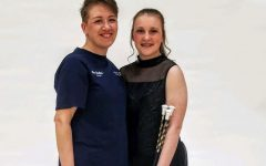 Grace and her coach, Heather, pose for a photo together during Grace's first year of competition baton twirling.