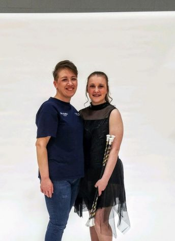 Grace and her coach, Heather, pose for a photo together during Grace
