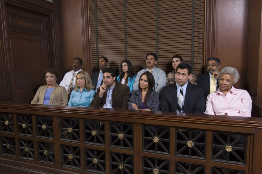 This photograph is of a group of jurors in a court case.