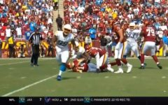Washington quarterback, Ryan Fitzpatrick on the ground after getting hit by a Charger defender. Also if you look toward the top left, you can see myself with my long hair wearing a burgundy #99 jersey. My best friend, Landon Small, is next to me wearing the blue # 85 jersey, but his head is cut off.