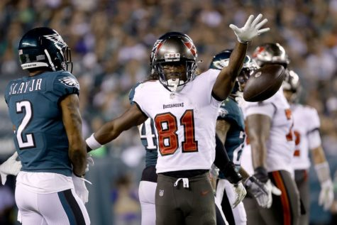 Tampa Bay Buccaneers wide receiver Antonio Brown dropping the ball, after catching a pass from quarterback Tom Brady in route to defeating the Philadelphia Eagles on Thursday Night Football.