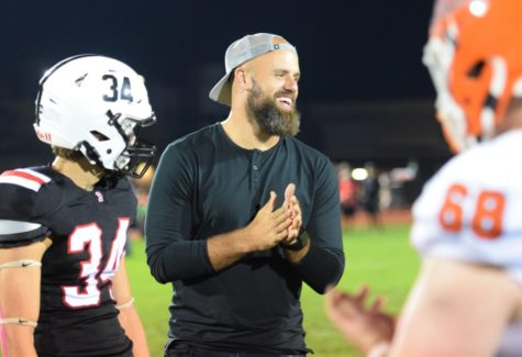Former Boyertown high school football player, and three time Super Bowl champion with the New England Patriots, smiling during the captains meeting, as he was the honorary captain for the game.